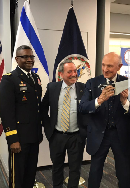 Former CIA Director James Woolsey (right) holding a drone designed by Israeli company Colugo who are considering building their U.S. Operations in Virginia; Maj. Gen. Patrick Burden - Army Futures Command (Left) and Virginia Israel Advisory Board Executive Director Dov Hoch (Center).